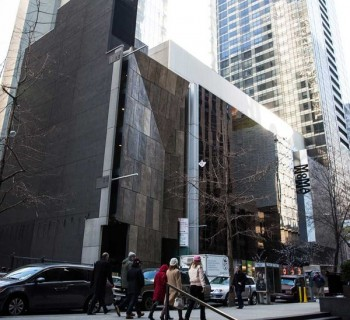 Moma's facade, with AFAM's facade at corner. (Andrew Burton/Getty Images)