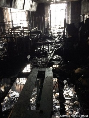 Wreckage inside the Mackintosh Library. (Glasgow Fire and Rescue via BBC)