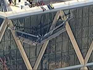 Window washers hanging from Hearst Tower. (abcnews.go.com)