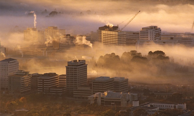 Canberra, a pretty picture, with fog that doesn't hide enough. (The Guardian)