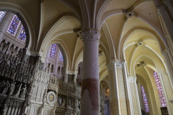 At Chartres, darker hues fashioned by time (left) change to lighter hues. (Hubert Fanthomme/Getty Images)