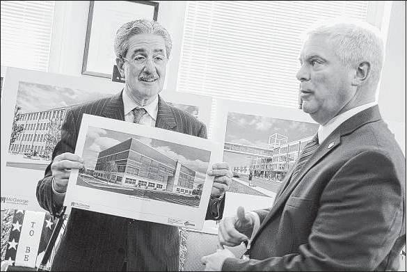 Developer Michael Integlia (holding illustration) and Warwick Mayor Scott Avidesian. (Journal photo by Sandor Bodo)