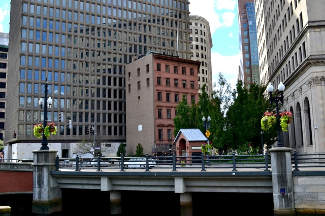 Tiny Merchants Bank Building next to Textron Building, seen from across Providence River. (ricurrency.com)