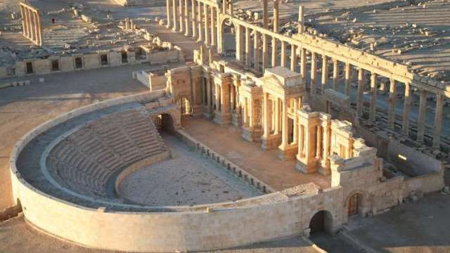An aerial view taken in 2009 shows Palmyra's impressive amphitheater. Immediately behind it is the 3,600-foot long colonnade that welcomed visitors to the city. (Christophe Charon / AFP/Getty Images)