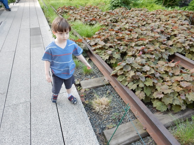 My son Billy stands next to iconic trackage at New York's High Line. (Photos by David Brussat)