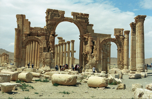The monumental arch in the eastern section of Palmyra's colonnade. (Wikipedia)
