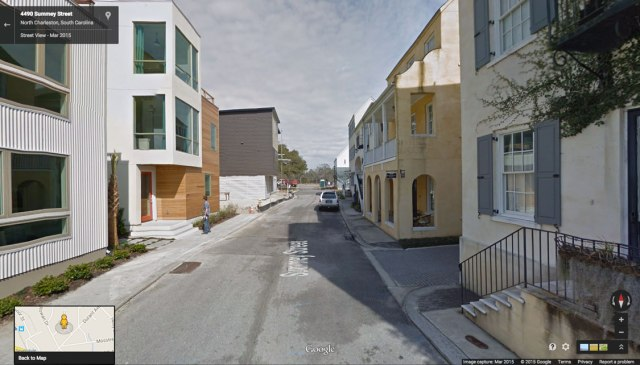 The modern and traditional architecture on either side of this street are part of the same project in Charleston.